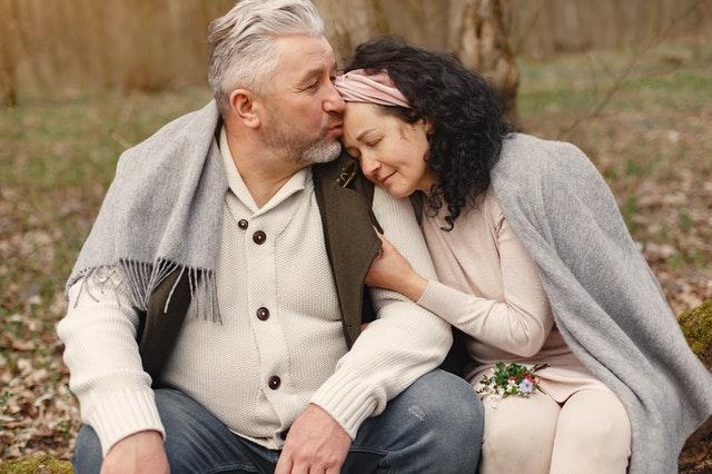 happy-senior-couple-hugging-in-autumn-park