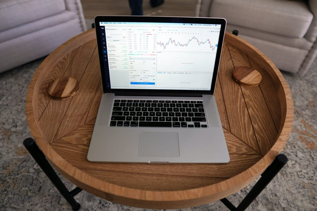laptop on a circular wooden table