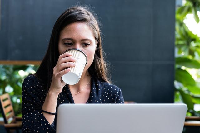 woman facing laptop